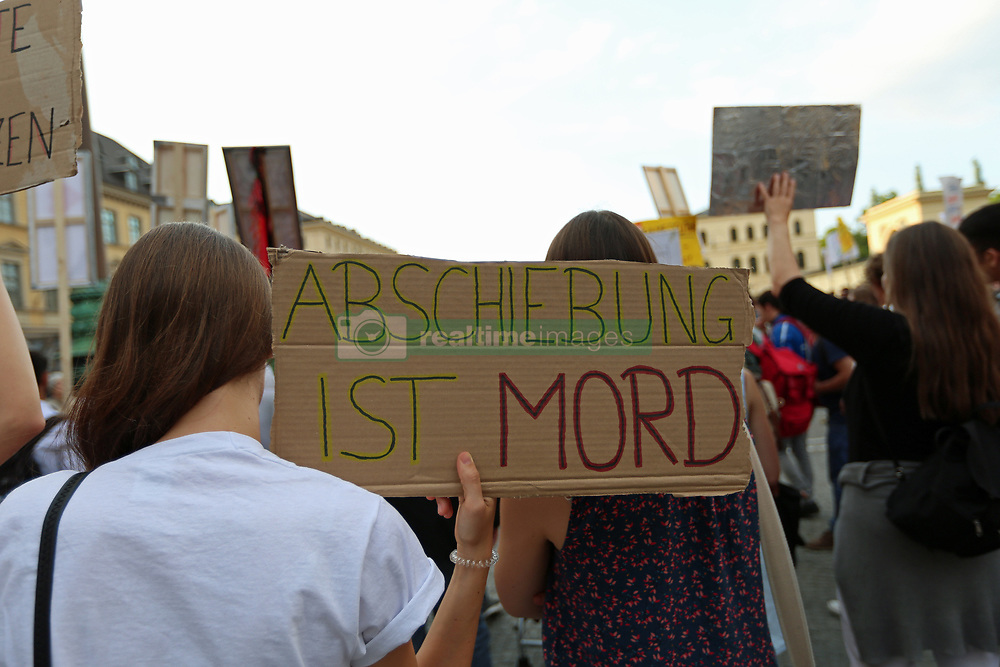 May 31, 2017 - Munich, Bavaria, Germany - ''Deportation is murder''.Hundreds of people gathered on Munich's Odeonsplatz to protest against deportations. The demonstration should have taken place at the airport, but the deportation flight to Afghanistan was cancelled, because of security reasons for the workers of the embassy. (Credit Image: © Alexander Pohl/Pacific Press via ZUMA Wire)