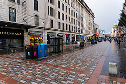Glasgow, Scotland, UK. 21 November 2020. Views of Saturday afternoon in Glasgow city centre on first day of level 4 lockdown. Non essential shops and businesses have closed. And streets are very quiet. Pictured; Argyle Street is almost deserted   .Iain Masterton/Alamy Live News
