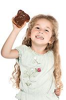caucasian little girl portrait show chocolate slice happy isolated studio on white background