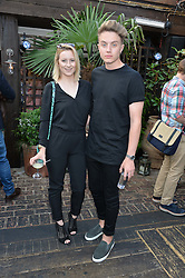 ROMAN KEMP and HOLLY FILTNESS at the Warner Music Group Summer Party in association with British GQ held at Shoreditch House, Ebor Street, London E2 on 8th July 2015.