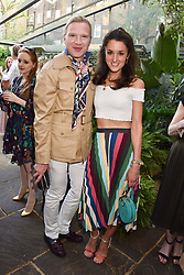 Henry Conway and Rosanna Falconer at The Ivy Chelsea Garden Summer Party, Kings Road, London, England. 14 May 2018.