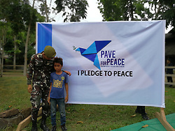 April 17, 2018 - Isabella City, Philippines - Tamir, a 10 years old Abu Sayyaff who attended the inauguration of Program Against Violent Extremism (PAVE) for Peace in 4th Special Forces Battalion in Isabela, Basilan. He grow up inside Abu Sayyaff camp in Sumisip after his parents died when he was 10 months old. (Credit Image: © Sherbien Dacalanio/Pacific Press via ZUMA Wire)