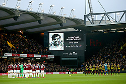 Burnley and Watford players stand in respect as a picture of the recently departed Duncan Welbourne is shown on the big screen during the Premier League match at Vicarage Road, Watford.