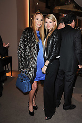 Left to right, MARIANA BEOCHANSKAIA and AMY RICKER at a party to celebrate the publication of Nathalie von Bismarck's book 'Invisible' held at Asprey, 167 New Bond Street, London on 9th December 2010.