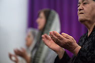 Iraqi Christian women raise their hands in worship during a service at St. John the Baptist church (Ancient Church of the East) in Kirkuk, Iraq. (May 21, 2017)