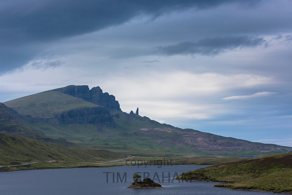 The Storr escarpment and The Old Man of Storr rock pinnacle (stack) in Trotternish Ridge with Loch Fada on the Isle of Skye in the Highlands and Islands of Scotland
