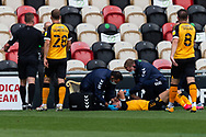 Newport County's Scott Twine (19) is injured during the EFL Sky Bet League 2 match between Newport County and Tranmere Rovers at Rodney Parade, Newport, Wales on 17 October 2020.