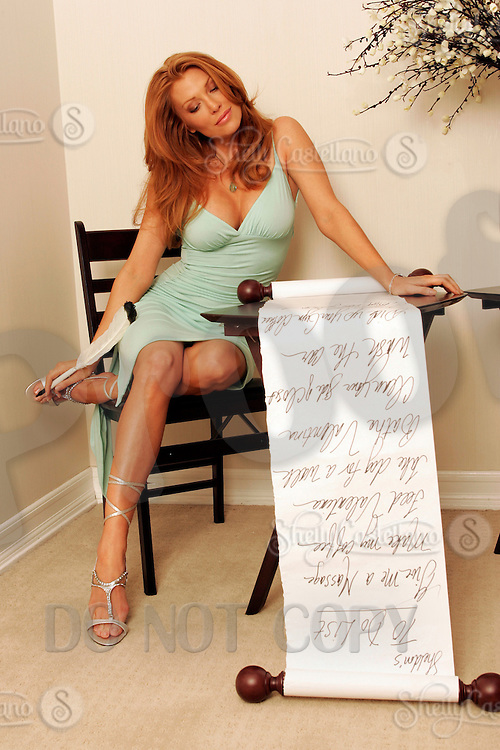 22 June 2005:  Angelica Bridges wife of Sheldon Souray of the Montreal Canadiens, poses in the bedroom with a 'Honey To Do List'  during The Not so Desperate, Desperate housewives shoot on location in Los Angeles with NHL hockey players wives for Editorial Use Only!  Mandatory Credit:  Shelly Castellano.com or Price Doubles. .