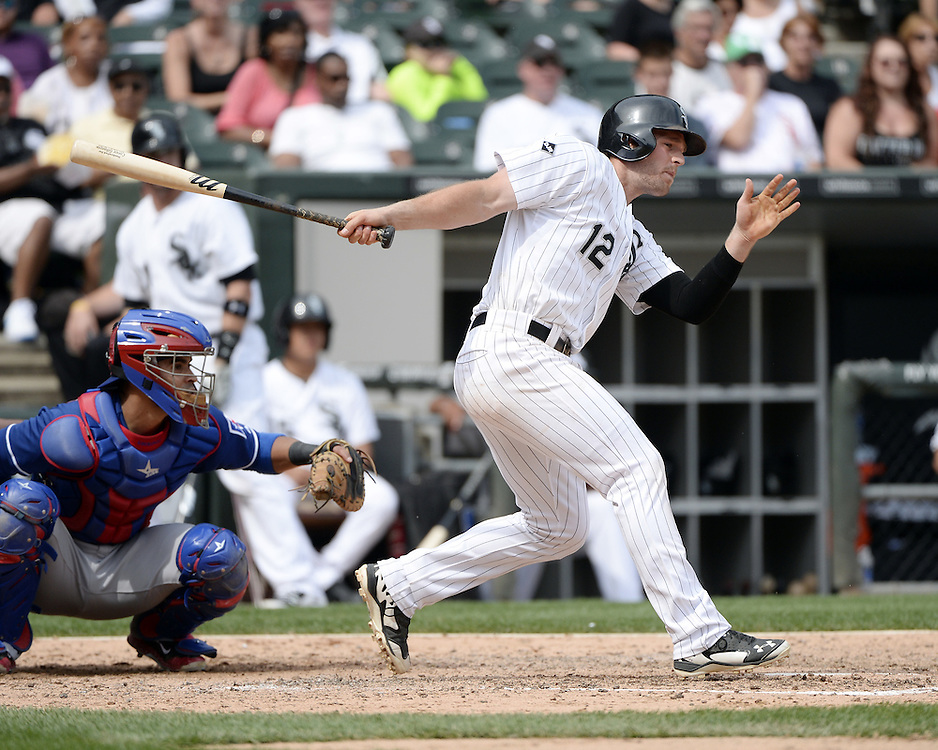 CHICAGO - AUGUST 06:  Conor Gillaspie #12 of the Chicago White Sox bats against the Texas Rangers on August 6, 2014 at U.S. Cellular Field in Chicago, Illinois.  (Photo by Ron Vesely)