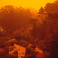 Smoke from California wildfires paint the sky orange and darkens the day in Montara, California on September 9, 2020.