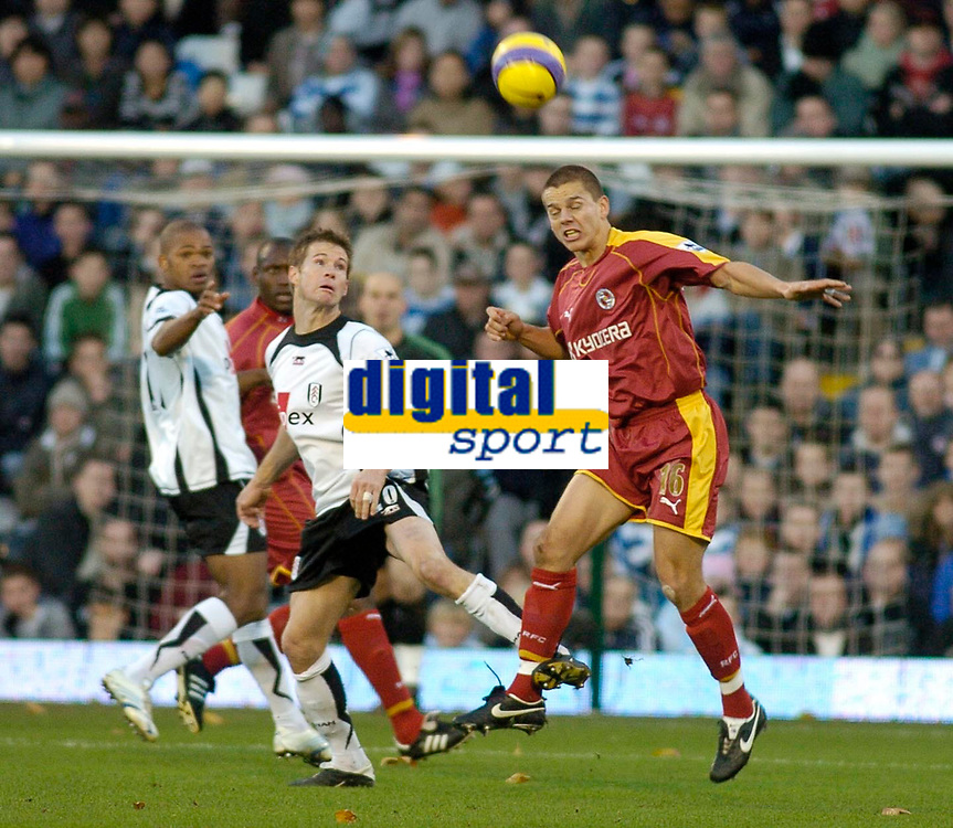 Photo: Gareth Davies.<br />Fulham v Reading. The Barclays Premiership. 25/11/2006.<br />Reading defender Ivar Ingimarsson (R) clears the ball away from the Reading box.
