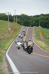 Clyde Crouch riding his 1929 Henderson KJ at the head of a group of Cannonballers during Stage 7 of the Motorcycle Cannonball Cross-Country Endurance Run, which on this day ran from Sedalia, MO to Junction City, KS., USA. Thursday, September 11, 2014.  Photography ©2014 Michael Lichter.