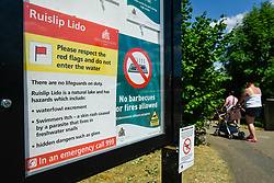 © Licensed to London News Pictures. 01/06/2020. LONDON, UK.  A sign warning visitors not to enter the water at Ruislip Lido in north west London.  Hillingdon Council has closed the beach to the public following several days where the public were not adhering to social distancing as coronavirus pandemic lockdown restrictions have been eased by the UK government.  On the first day of the meteorological summer, visitors who travelled from out of the area resorted to finding a place to sunbathe on any patch of grass they could find.  Photo credit: Stephen Chung/LNP