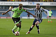 Lys Mousset of Bournemouth and Aiden O'Brien of Millwall compete for the ball. The Emirates FA Cup 3rd round match, Millwall v AFC Bournemouth at The Den in London on Saturday 7th January 2017.<br /> pic by John Patrick Fletcher, Andrew Orchard sports photography.