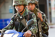 """Sept. 25, 2009 -- PATTANI, THAILAND: Thai soldiers patrol downtown Pattani, Thailand on motorcycles. Thailand's three southern most provinces; Yala, Pattani and Narathiwat are often called """"restive"""" and a decades long Muslim insurgency has gained traction recently. Nearly 4,000 people have been killed since 2004. The three southern provinces are under emergency control and there are more than 60,000 Thai military, police and paramilitary militia forces trying to keep the peace battling insurgents who favor car bombs and assassination.  Photo by Jack Kurtz / ZUMA Press"""