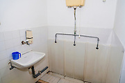 communal Urinal and wash basin