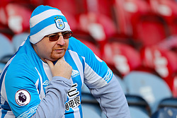 A Huddersfield Town fan in the stands ahead of the Premier League match at the John Smith's Stadium, Huddersfield.