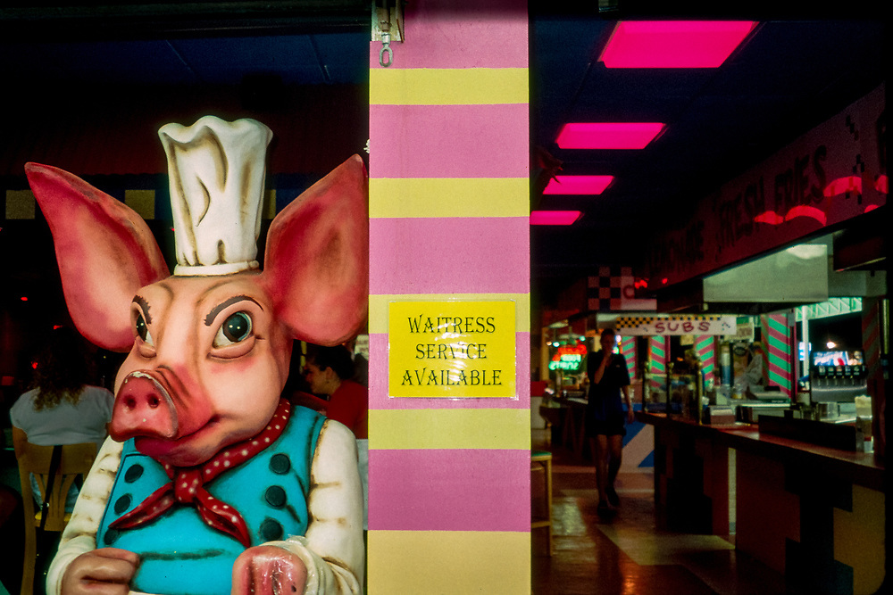 Large pig dressed as a chef at food vendor on the Seaside Heights, New Jersey boardwalk