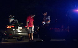 October 13, 2017 - Cordele, GA - Georgia State Trooper performs sobriety test on suspected drunk driver following a traffic stop in rural Georgia. (Credit Image: © Robin Rayne Nelson via ZUMA Wire)
