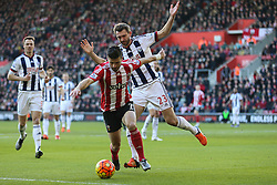Shane Long of Southampton under pressure from Gareth McAuley of West Bromwich Albion - Mandatory by-line: Jason Brown/JMP - 07966386802 - 16/01/2016 - FOOTBALL - Southampton, St Mary's Stadium - Southampton v West Bromwich Albion - Barclays Premier League