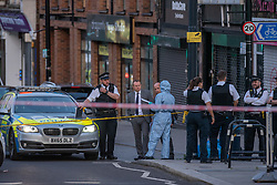 © Licensed to London News Pictures. 08/09/2019. London, UK. Metropolitan Police were called to reports of suspicious activity in Sydenham Road, Lewisham. Shots were subsequently heard and firearms officers were also called to the scene along with the London Ambulance Service. A man in his 20s was found with gunshot wounds. He died at the scene at 15:50BST. Photo credit: Peter Manning/LNP