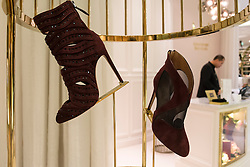 Shoes on display in shop in Level Shoe District  in Dubai Mall United Arab Emirates