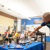 Dr. Bill Gutman uses a balloon and a vacuum to show the effects space has on the body during a presentation by Spaceport America Tuesday, Oct. 1 at Gallup Middle School.