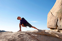 """Man in yoga pose bound lunge outdoors in a spectatcular stone landscape.<br /> :::<br /> tapasvibhyo 'dhiko yogi <br /> jnanibhyo 'pi mato 'dhikah <br /> karmibhyas cadhiko yogi <br /> tasmad yogi bhavarjuna<br /> <br /> """"A yogi is greater than the ascetic, greater than the empiricist and greater than the fruitive worker. Therefore, O Arjuna, in all circumstances, be a yogi.""""<br /> -Bhagavad Gita"""