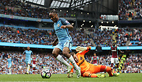 Football - Raheem Sterling of Manchester City goes round Adrian of West Ham United to score during the match at the Etihad Stadium between Manchester City and West Ham United. <br /> <br /> 2016 / 2017 Premier League - Manchester City vs. West Ham United<br /> <br /> -- at The Etihad Stadium.<br /> <br /> COLORSPORT/LYNNE CAMERON