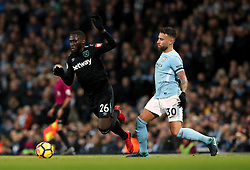 West Ham United's Arthur Masuaku (left) and Manchester City's Nicolas Otamendi (right) battle for the ball during the Premier League match at the Etihad Stadium, Manchester.