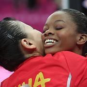 Kexin He, China, (left) is congratulated by Gabrielle Douglas, USA, (right) after winning the Silver Medal in the Gymnastics Artistic, Women's Apparatus, Uneven Bars Final at the London 2012 Olympic games. London, UK. 6th August 2012. Photo Tim Clayton