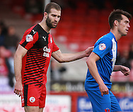 Crawley Town central defender Joe McNerney keeps tight to Leyton Orient striker John Marquis, on loan from Millwall,  during the Sky Bet League 2 match between Crawley Town and Leyton Orient at the Checkatrade.com Stadium, Crawley, England on 10 October 2015. Photo by Bennett Dean.