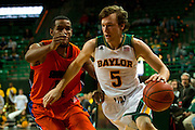 WACO, TX - JANUARY 3: Brady Heslip #5 of the Baylor Bears drives to the basket against the Savannah State Tigers on January 3, 2014 at the Ferrell Center in Waco, Texas.  (Photo by Cooper Neill) *** Local Caption *** Brady Heslip