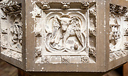 Historic interior of East Bergholt church, Suffolk, England, UK baptismal font stonework detail