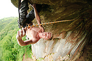 Char Williams making the final clip of Thormen's Moth, 8a, Thor's Cave, Peak District
