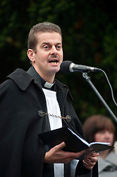Vicar Rick Stordy of St Johns Church Chapeltown lead the prayers at the local War Memorial in Chapeltown Park Sheffield South Yorkshire, during a local Remembrance Day service on Sunday.13 November 2011. Image © Paul David Drabble