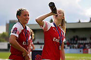 Arsenal defender Leah Williamson (6) drinks champagne after  the FA Women's Super League match between Arsenal Women FC and Manchester City Women at Meadow Park, Borehamwood, United Kingdom on 12 May 2019.