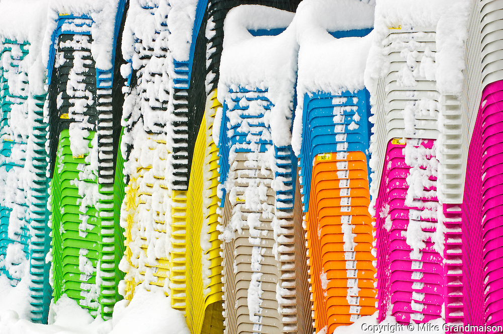 Pattern of stacked chairs in winter covered in snow<br /> Dorset<br /> Ontario<br /> Canada