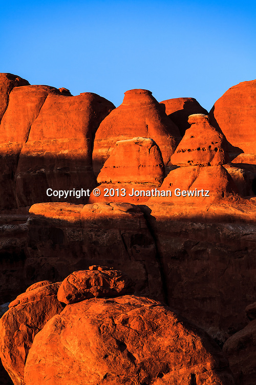 The Fiery Furnace geological formation in Arches National Park, Utah in warm, late-afternoon sunlight. WATERMARKS WILL NOT APPEAR ON PRINTS OR LICENSED IMAGES.<br /> <br /> Licensing: https://tandemstock.com/assets/59831716