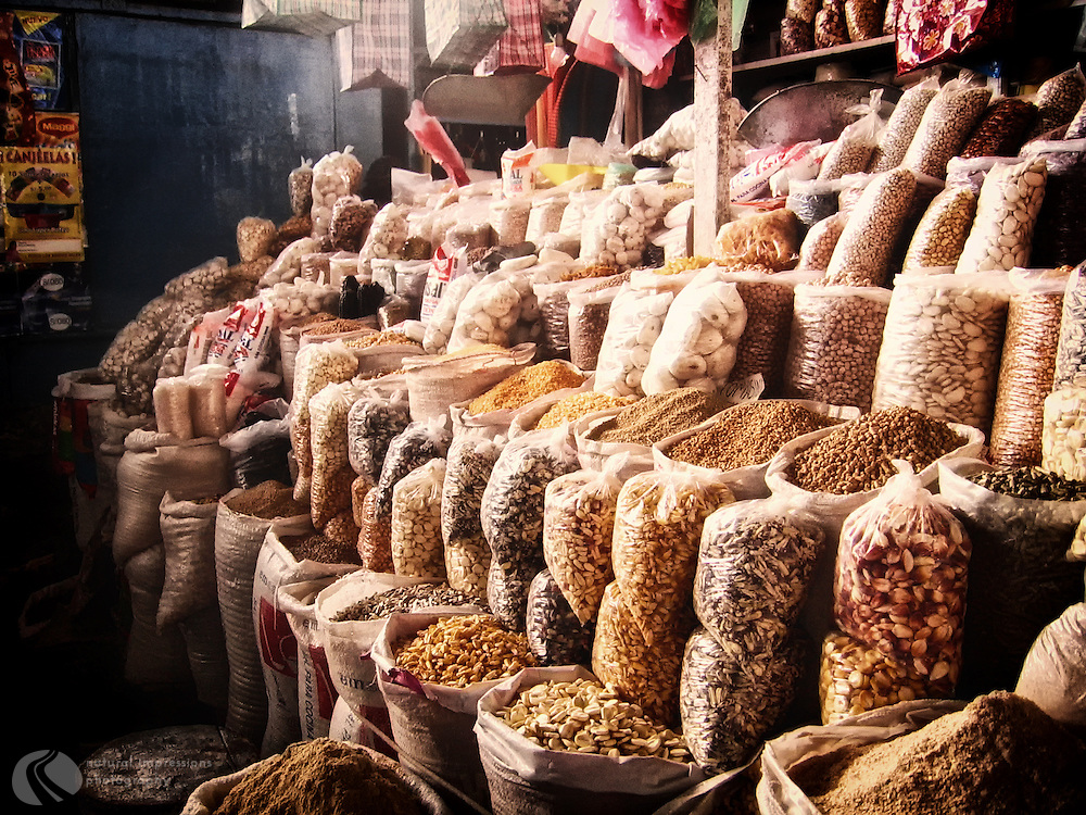 Corn and grains for sale at the Cusco Market in Peru.