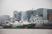Greenpeace ship Esperanza docked alongside HMS Belfast on the River Thames in London, United Kingdom. Greenpeace is a non-governmental environmental organization with offices in over 39 countries.