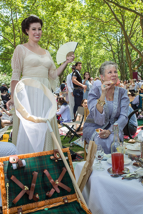 Two women with a vintage picnic kit and a butterfly net at the eighth annual Jazz Age Lawn Party.
