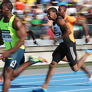 Yohan Blake, (right), Jamaica, finishing second to Nesta Carter, (left), Jamaica, in the BMW Men's 100m during the Diamond League Adidas Grand Prix at Icahn Stadium, Randall's Island, Manhattan, New York, USA. 14th June 2014. Photo Tim Clayton
