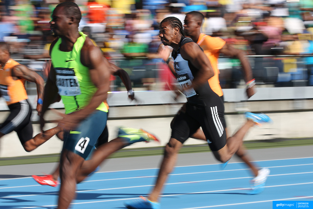 Yohan Blake, (right), Jamaica, finishing second to Nesta Carter, (left), Jamaica, in the BMW Men's 100m during the Diamond League Adidas Grand Prix at Icahn Stadium, Randall's Island, Manhattan, New York, USA. 14th June 2014. Photo Tim Clayton