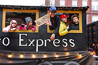 """The """"Cereal Hero Express"""" rolls through downtown during the Light Up Laconia Holiday Parade on Sunday afternoon.  (Karen Bobotas/for the Laconia Daily Sun)"""