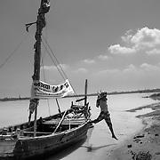 IEC materail on a boat operating on the Ganga river near Patna, Bihar