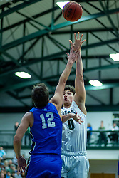 BLOOMINGTON, IL - January 04: Matthew Leritz shoots over Calvin Fisher during a college basketball game between the IWU Titans  and the Millikin Big Blue on January 04 2020 at Shirk Center in Bloomington, IL. (Photo by Alan Look)