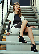 Model Taylor Benson posing on stairway of a West Seattle Art Deco style home. She is wearing clothing designed by Jessica Smith and styled by Kaitlin Esary. The hair and make was done by Ebony Williams.