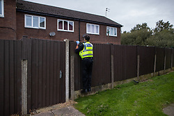© Licensed to London News Pictures . 11/09/2020. Bolton , UK . PC TONY LOWE investigates after a report , believed to be false , that people were gathered in breach of Coronavirus prevention regulations , in the garden of a house in Westhoughton . Police officers from Greater Manchester Police and Environmental Health Officers from Bolton Council respond to concerns of breaches of Coronavirus regulations , as stricter lockdown measures and a curfew on hospitality businesses are imposed in the borough to limit the spread of Covid-19 . Photo credit : Joel Goodman/LNP