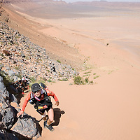 26 March 2007:  2006 winner of the women race Geraldine Courdesses of France reaches summit of jebel El Otfal, 947 meters and an average 25% slope, during the second stage (21.7 miles) of the 22nd Marathon des Sables between Khermou and jebel El Otfal. The Marathon des Sables is a 6 days and 151 miles endurance race with food self sufficiency across the Sahara Desert in Morocco. Each participant must carry his, or her, own backpack containing food, sleeping gear and other material.